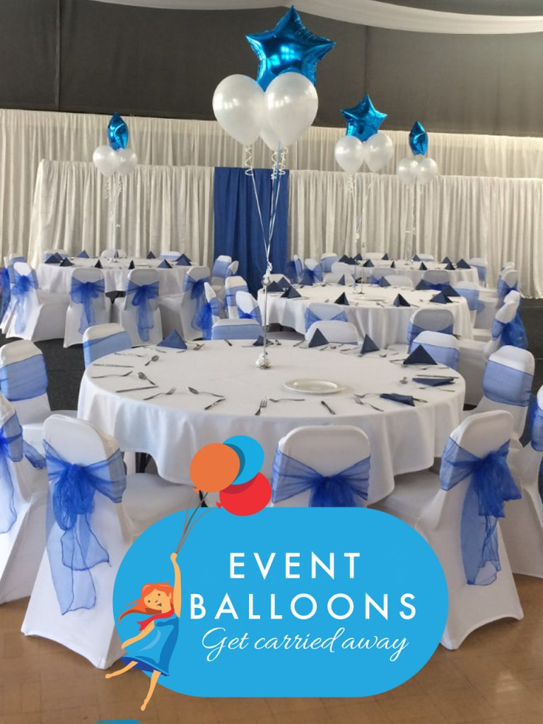 round white tables with white chairs with blue sashes and white and blue balloons